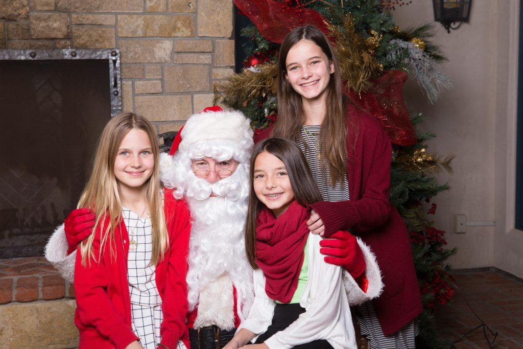 Three girls with Santa of San Diego