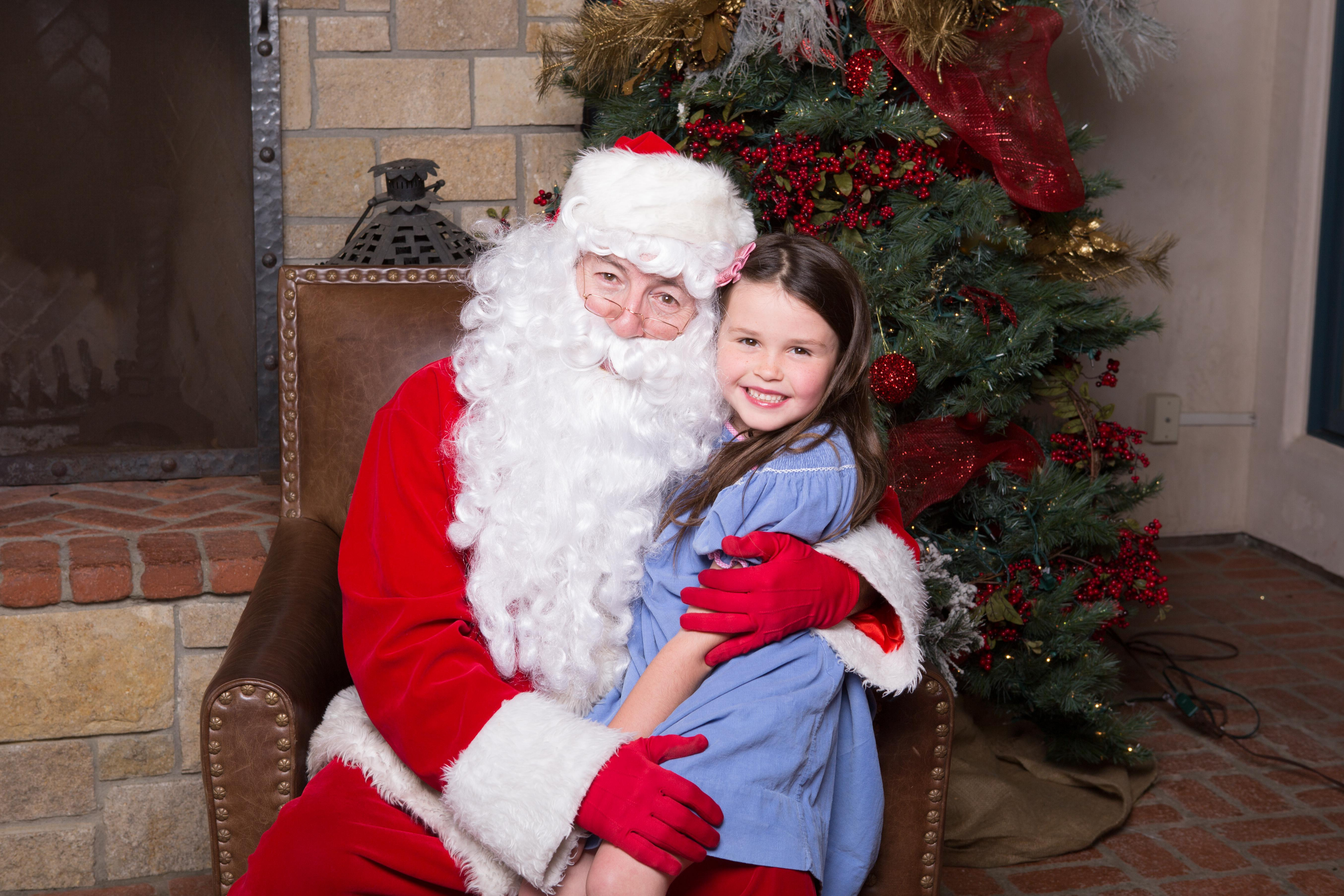 Happy girl with Santa of San Diego