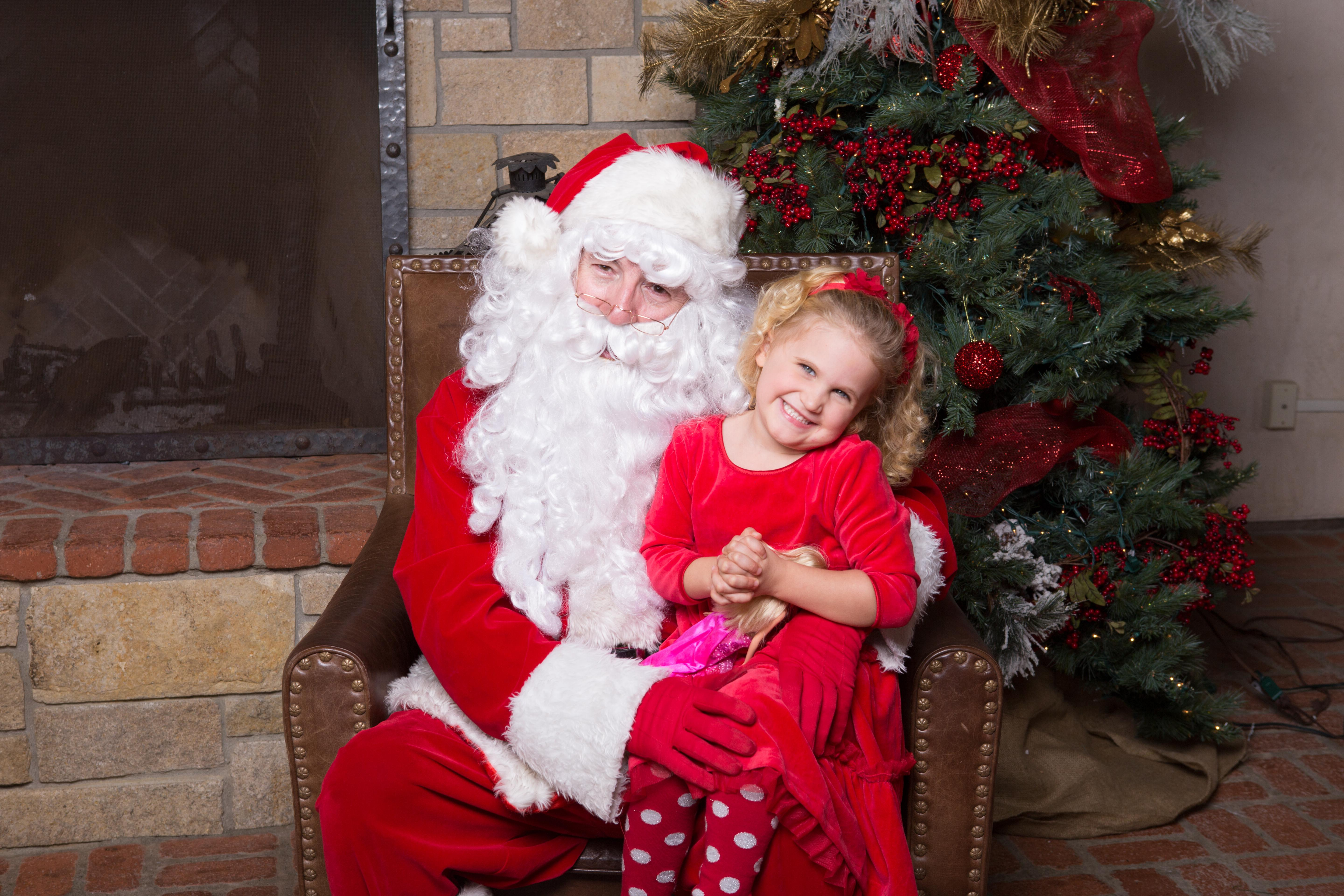 Happy blonde girl with Santa of San Diego